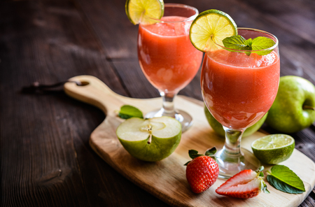 vitamin rich: Fresh organic smoothie with apple, strawberry and lime in a glass jar Stock Photo