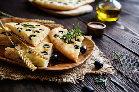 sprinkled: Traditional Italian Focaccia with black olives and rosemary