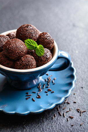 Brigadeiro - traditional Brazilian delicacy made of condensed milk, cocoa powder, butter and chocolate sprinkles