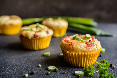 Salty muffins with bacon, green onion and cheese