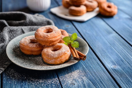 Traditional American doughnuts with cinnamon and sugar icing Stock Photo