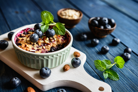 Baked blueberry crumble with oat flakes and chopped almonds Stock Photo
