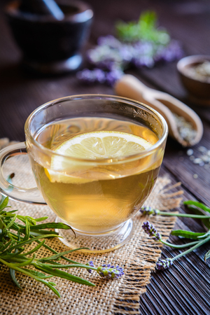 A cup of healthy lavender tea with lemon