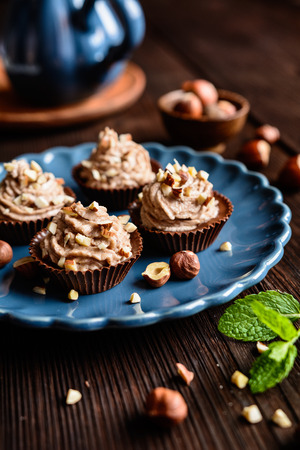 sprinkled: Delicious chocolate cups filled with hazelnut cream Stock Photo