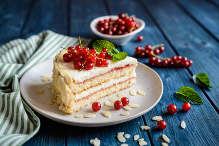 Delicious cake filled with mascarpone, whipped cream, red currant jam and decotated with almond slices