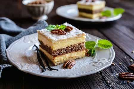 Delicious cremeschnitte with vanilla custard cream and pecan nut dough Foto de archivo