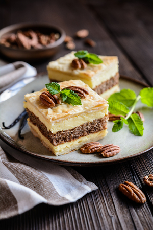 Delicious cremeschnitte with vanilla custard cream and pecan nut dough Reklamní fotografie - 82309759
