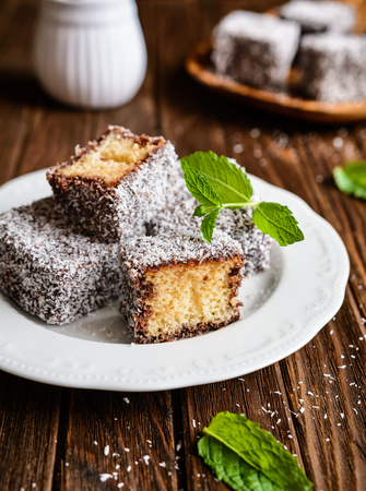 Australian Lamington cakes coated in a chocolate and shredded coconut