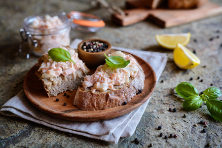 Delicious salmon spread with cream cheese and onion on whole grain bread slices Stock fotó