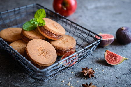 Sweet star anise shortbread sandwiches filled with grated apple and fig mixture Stok Fotoğraf