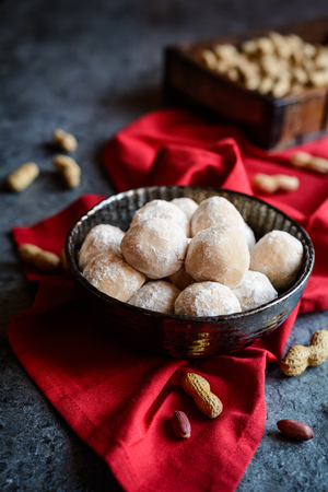 No bake peanut butter Snowballs with grated coconut and almond, covered in powdered sugar