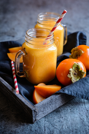 Healthy Persimmon smoothie in glass jars