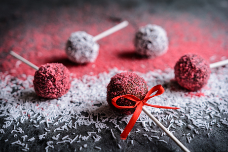 Delicious chocolate Cake pops decorated with red and white sprinkles Stock Photo