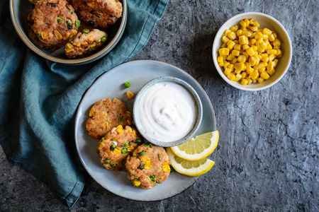 Healthy tuna Fish cakes with green peas, corn and scallion served with sour cream dip