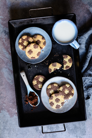 Cocoa and vanilla bicolor cookies with four leaf clover decoration
