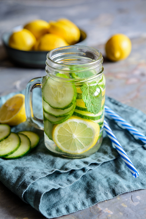 Healthy alkaline water with sliced cucumber, ginger, lemon and mint