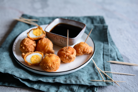Kwek Kwek - traditional deep fried quail eggs coated with batter served with soya sauce and vinegar dip