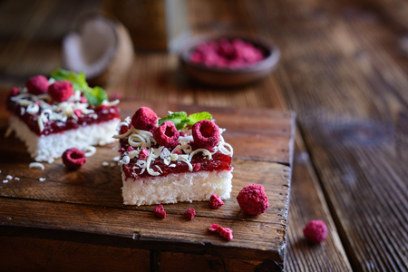 Delicious coconut cake with raspberry layer and freeze-dried raspberries Stock Photo