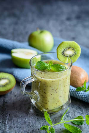 Healthy apple smoothie with kiwi and mint in a glass jar