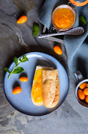 Homemade exotic kumquat jam with mandarins in a glass jar