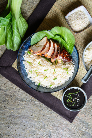 Baked teriyaki chicken breast with bok choy, served with rice Stock Photo - 118765615