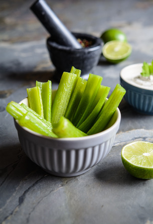 Healthy snack – fried celery stalks with sour cream dip