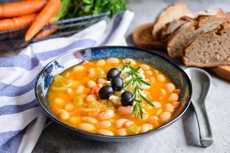 Fasolatha – delicious Greek white bean soup sprinkled with feta cheese Stock Photo - 119248021