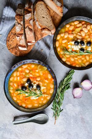 Fasolatha – delicious Greek white bean soup sprinkled with feta cheese Stock Photo - 119248023