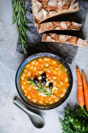 Fasolatha – delicious Greek white bean soup sprinkled with feta cheese Stock Photo - 119248024