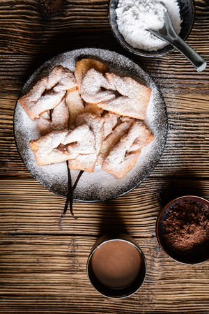 Homemade Calzones rotos – Chilean fried pastry, sprinkled with powdered sugar and served with hot chocolate Stock Photo - 119248025