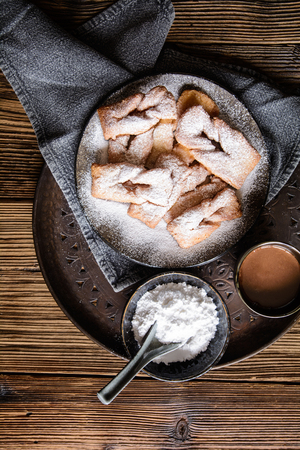 Homemade Calzones rotos – Chilean fried pastry, sprinkled with powdered sugar and served with hot chocolate