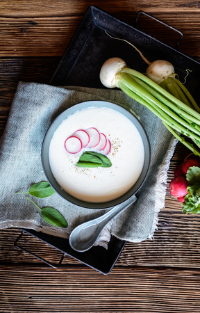 Nutritious creamy radish soup in a ceramic bowl Stock Photo - 119521372