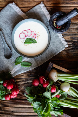 Nutritious creamy radish soup in a ceramic bowl Stock Photo - 119521373