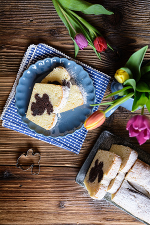 Sweet vanilla pound cake with Easter bunny inside, sprinkled with powdered sugar Stock Photo - 120142210