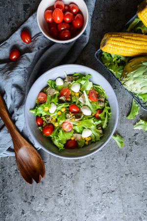 Easy to make healthy salad with baked artichoke, Mozzarella, tomatoes and corn Stock Photo