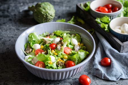 Easy to make healthy salad with baked artichoke, Mozzarella, tomatoes and corn Stock Photo - 120554074