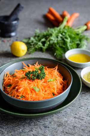 Traditional French grated carrot salad with mustard and honey Stock Photo - 120993862