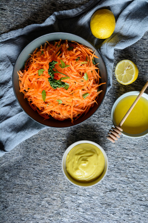 Traditional French grated carrot salad with mustard and honey