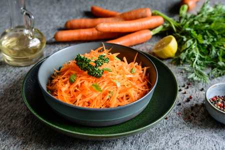 Healthy grated carrot salad with lemon juice and olive oil Stock Photo - 120993867