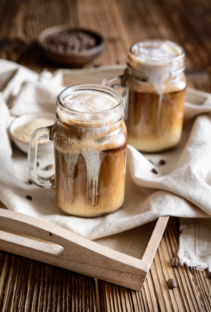 Delicious cold drink � iced coffee with ice and cream Stock Photo - 121890134