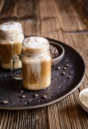 Delicious cold drink � iced coffee with ice and cream Stock Photo - 121890137