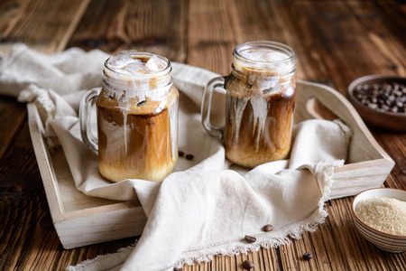 Delicious cold drink – iced coffee with ice and cream Stock Photo