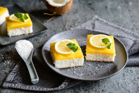 Delicious coconut bars with lemon curd on a plate Stock Photo