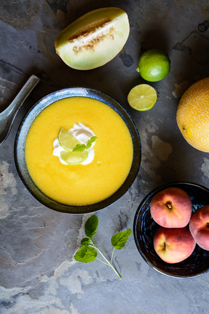 Refreshing  summer fruit soup with Galia melon and peaches