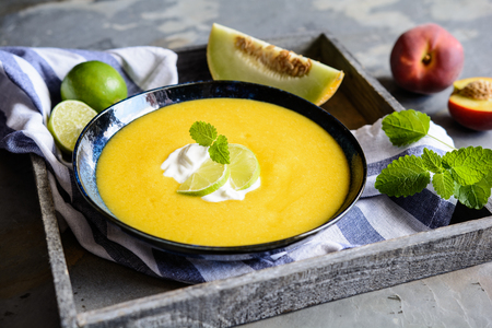 Refreshing  summer fruit soup with Galia melon and peaches Stock Photo - 124194222