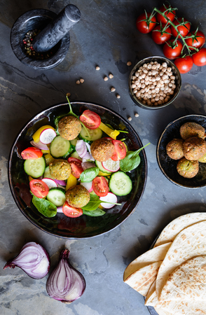 Homemade crispy chickpea Falafel with fresh salad and tortilla Stock Photo