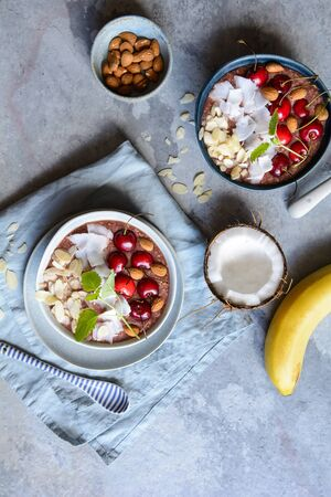 Healthy cherry coconut smoothie bowl with banana and almonds
