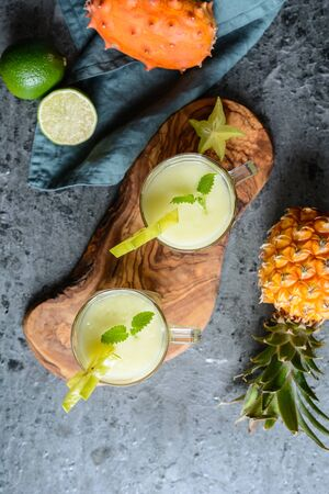 Healthy drink, kiwano and pineapple smoothie in a glass jar