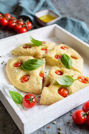 Sliced Italian Focaccia bread with tomatoes and basil