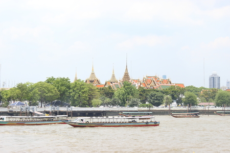 tour boats: Tour boats moored in front of the temple. bangkok thailand Stock Photo